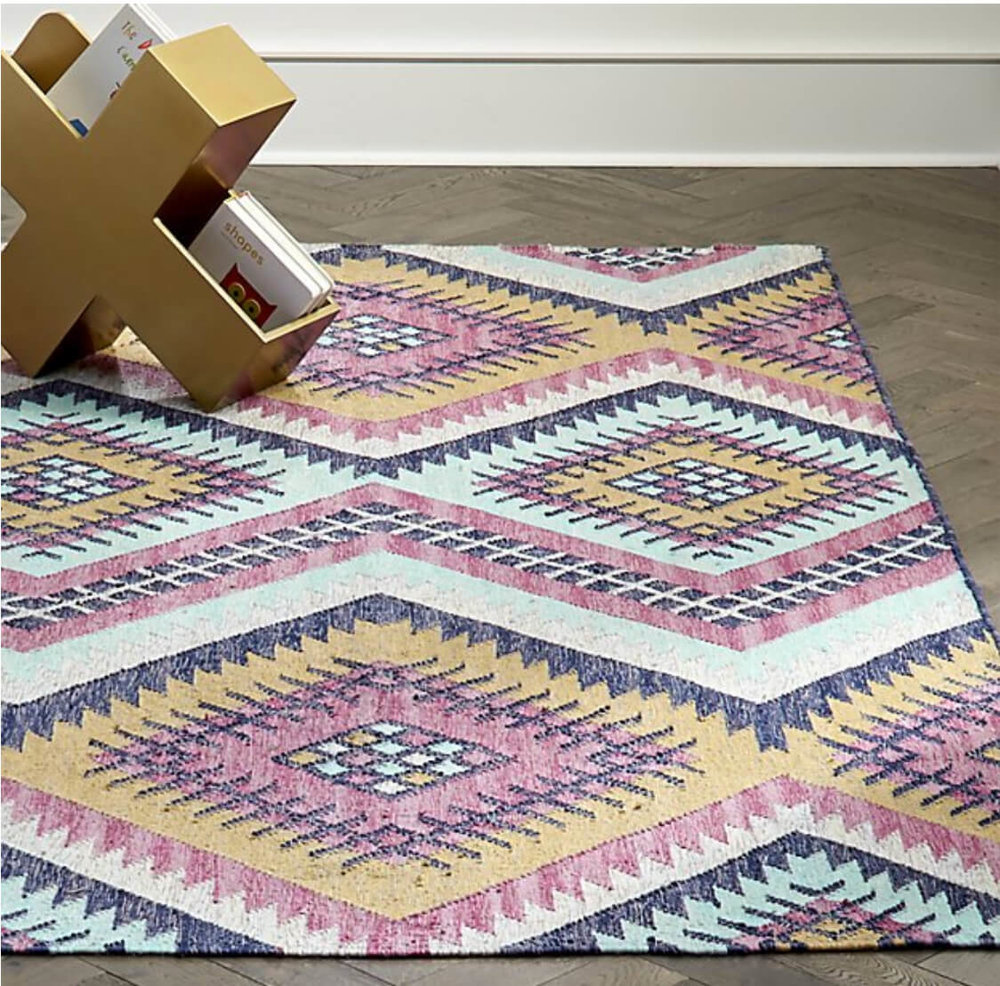 Bring colors outdoors with a pretty indoor/outdoor rug. Image:  Crate & Barrel