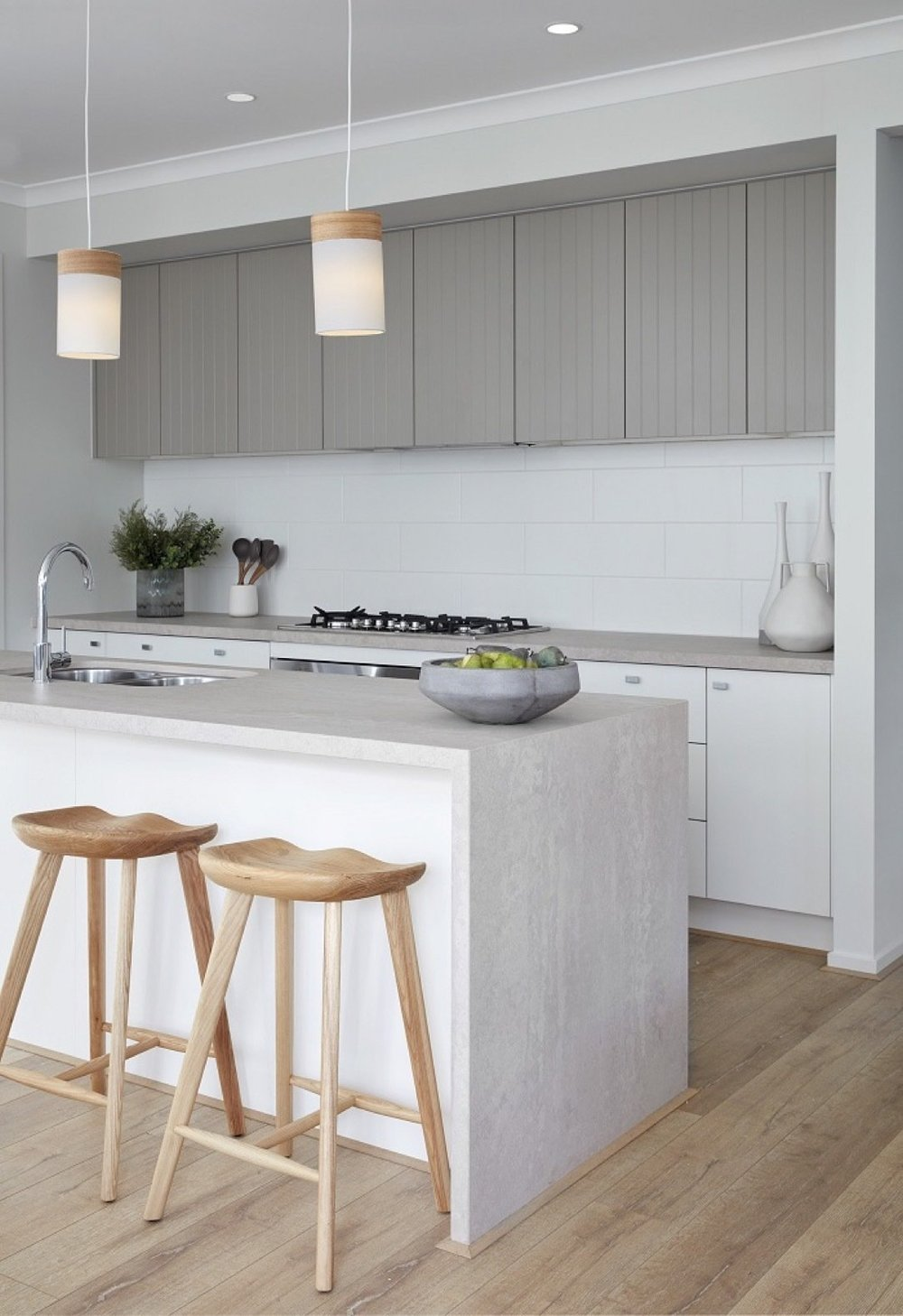 Caesarstone's seamless qualities makes the material a leading choice for dramatic waterfall kitchen countertops. Pictured here is 'Topus Concrete'.  Boutique Homes Victoria / Riva 26 Display Home