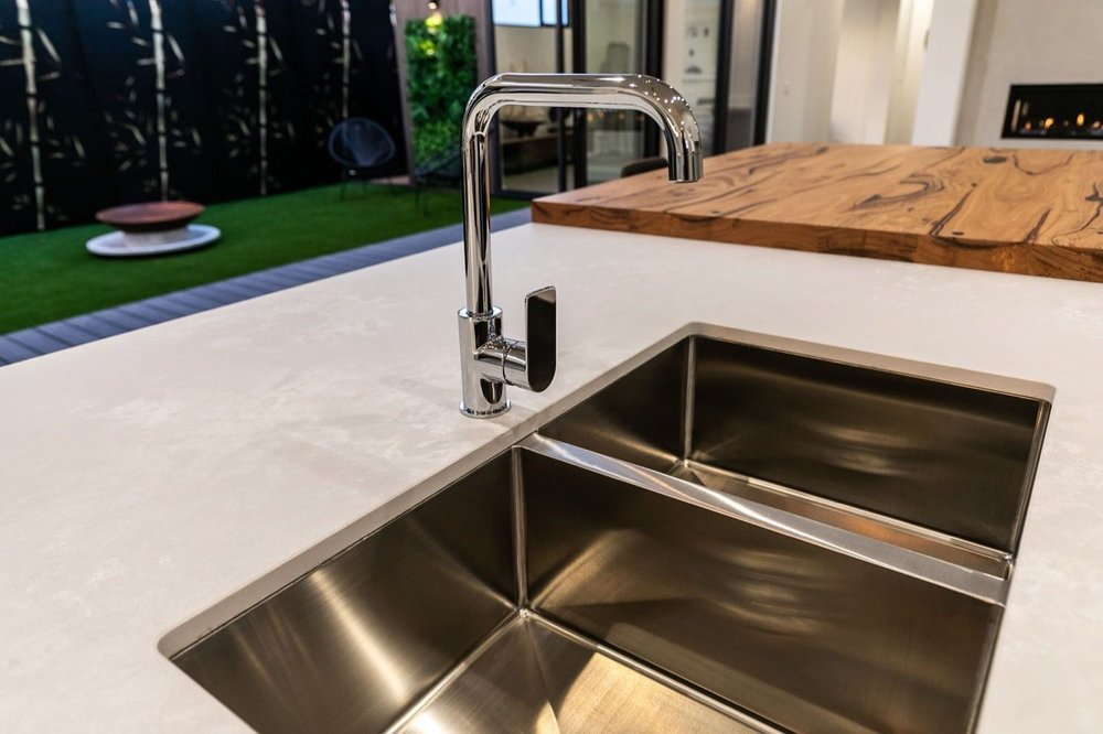 Caesarstone comes in a wide variety of finishes, including a low-reflective 'rough' finish with a matte look for the 'Cloudburst Concrete' surface.  Hudson Ridge Builders