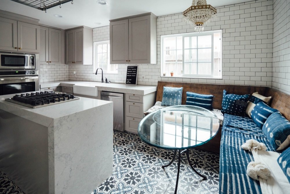 The neutral marble-like finish of Caesarstone in 'Noble Grey' balances out the varied textures and patterns in this kitchen.  Aimee Song