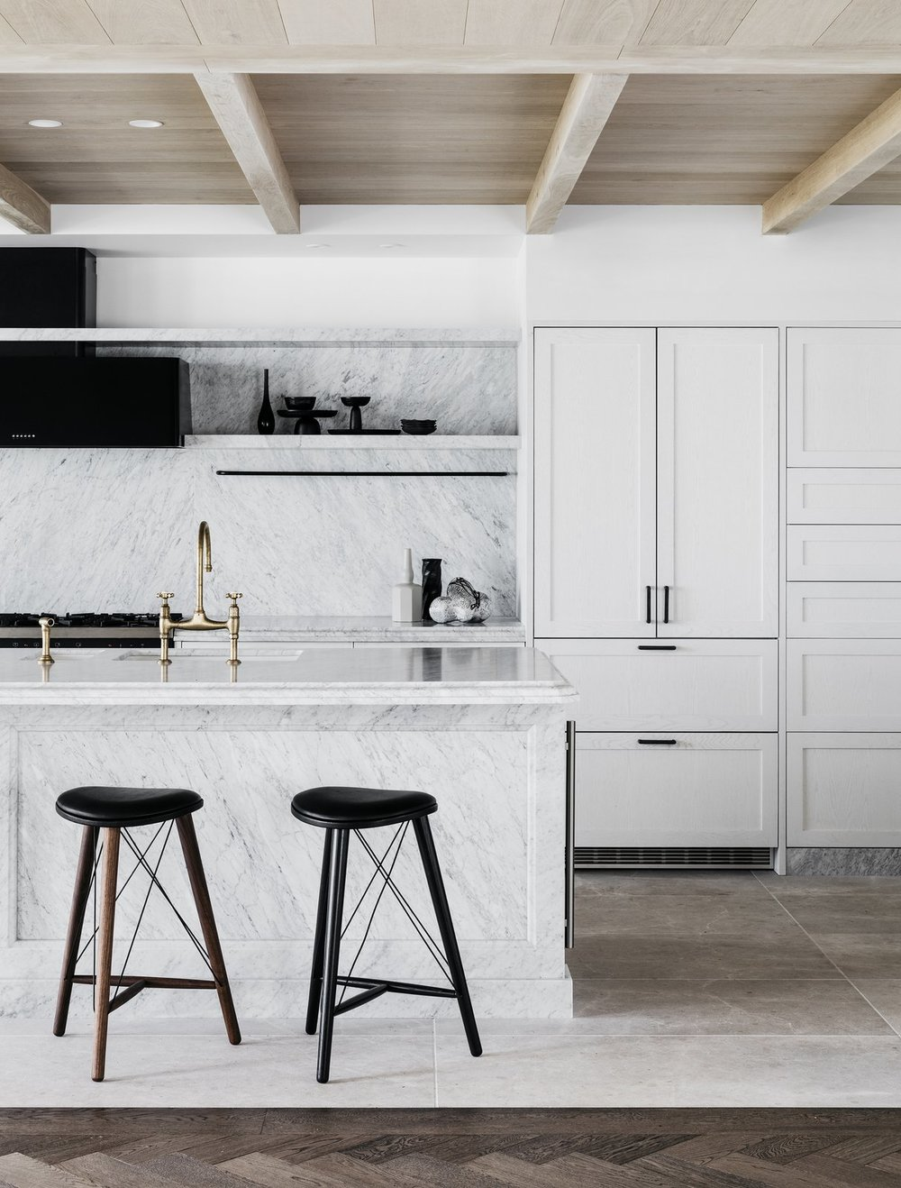 The monochromatic kitchen of the holiday villa evokes a calming mood.  Photo by Felix Forest