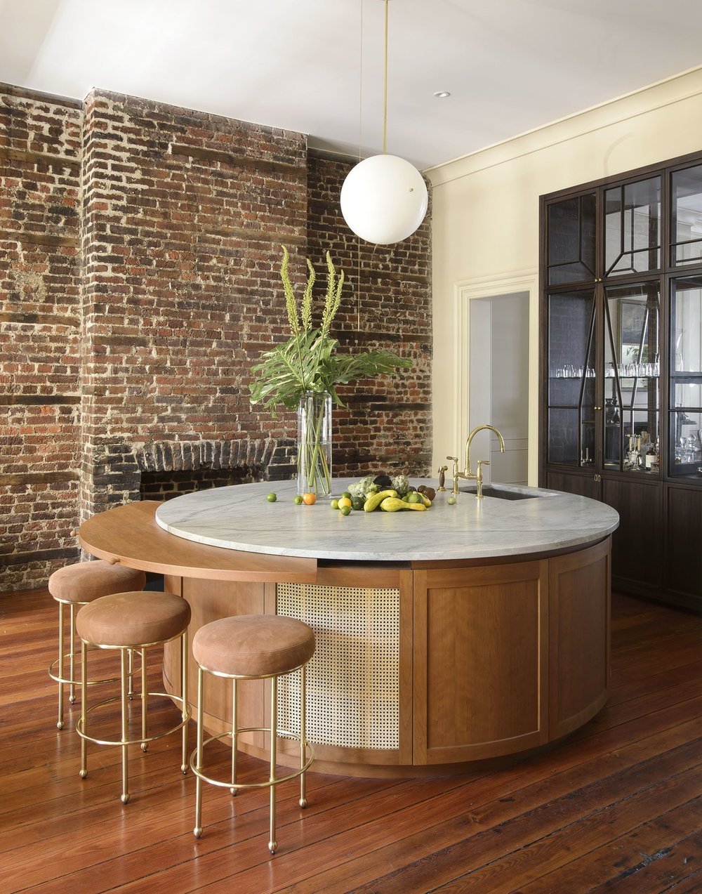 The house features a circular, marble-topped wet bar with Lawson Fenning Orsini stools.  Photo Courtesy of Matthew Williams