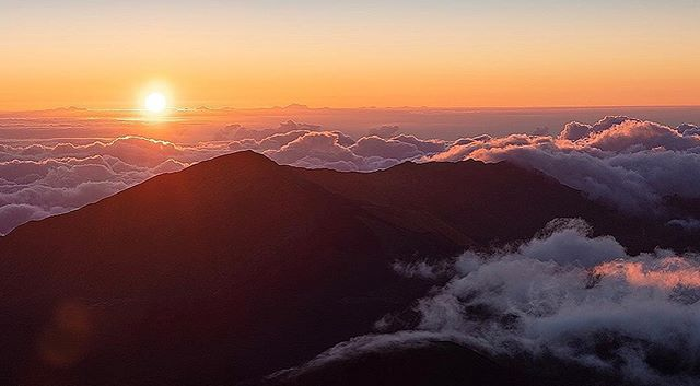 We're enjoying some time in Hawaii for our big summer trip. Two days ago we braved a 1:30am wake up time to head to the top of Mt. Haleakala to catch a glimpse of the most amazing sunrise we have ever seen! We were there with about 30 new friends as we caught the sun peeking out at around 5:45 am. Afterwards, we hiked for about an hour and began the drive back to the hotel. It was an amazing experience, and I'm looking forward to creating a nice wall print of this image (or one of the other 50 or so that I shot :) ).