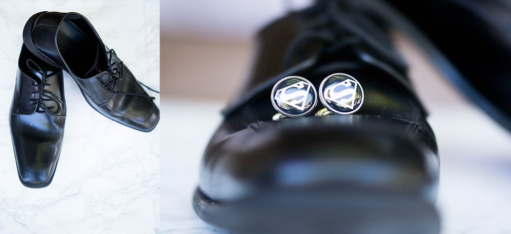 Grooms slick black shoes with super hero cufflinks.
