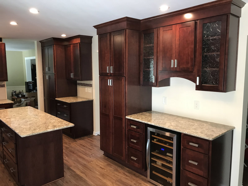 After - Pantry turned into standing cabinet; countertop lengthened; cabinets enlarged, while keeping the glass-front cabinet design in place.