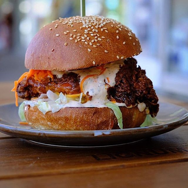 New hot chicken burger. 🍔Southern fried chicken with our special hot sauce, iceberg, cheese, pickled carrot and ranch sauce in a @janedoughwarrnambool milk bun. Takeaway or take a seat 🏖  #hotchicken #burgersofwarrnambool #southernfriedchicken
