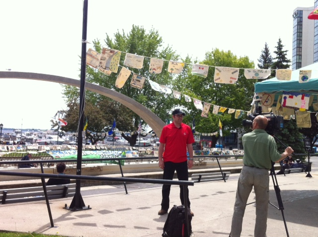 Being interviewed on National Clean Air Day with the Climate Action Clothesline in Confederation Park in Kingston, ON