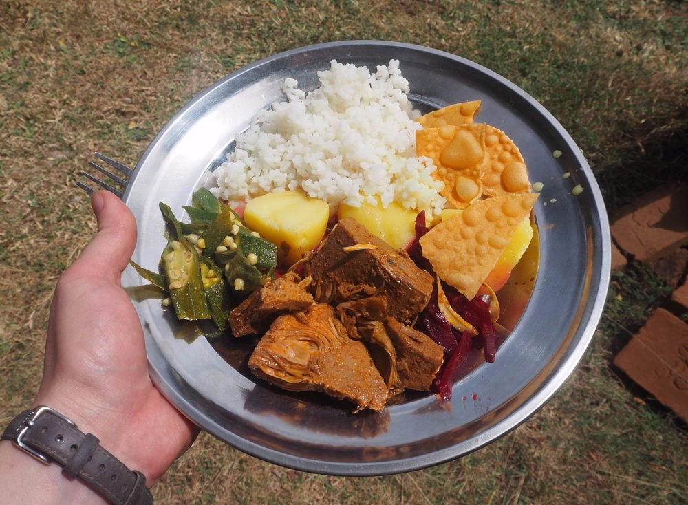 Full plate of veggie curries, rice and papadums