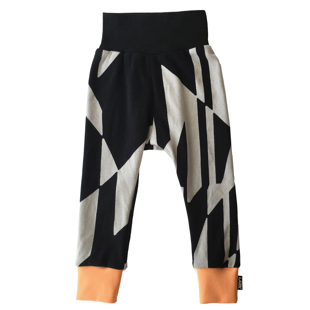 Dazzle Pants - Geometric print pants that will grow with your child - flip down the waistband or roll up the cuffs till you need the extra length. Lark have thought about how they produce their clothes, with the least impact environmentally. Don't forget to add the Mango Tango cuff colour for a bright pop. Dazzle Print Pants  £22  Lark