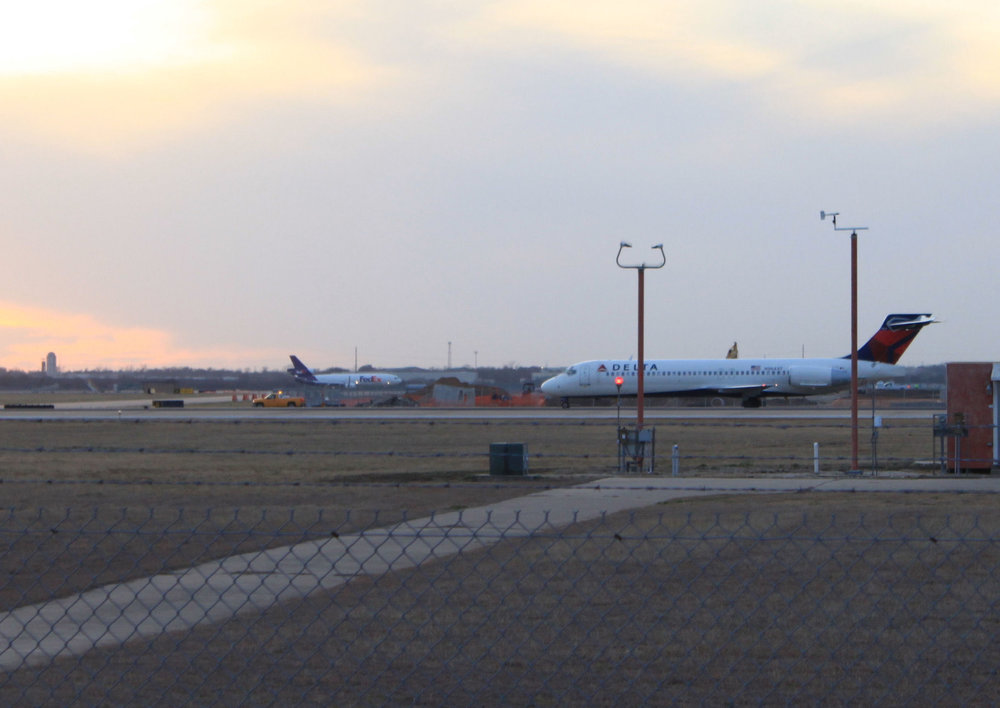A Fedex DC-10 in the background at Austin-bergstrom airport.