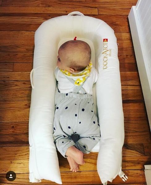Logan is so cute in his  DockaTot  and    Zara  baby overalls :)