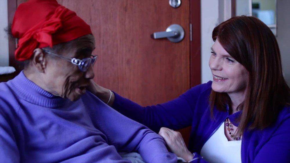 Woman Caregiver Smiling Purple.jpg