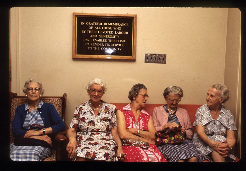 Ladies on Couch under sign.jpg