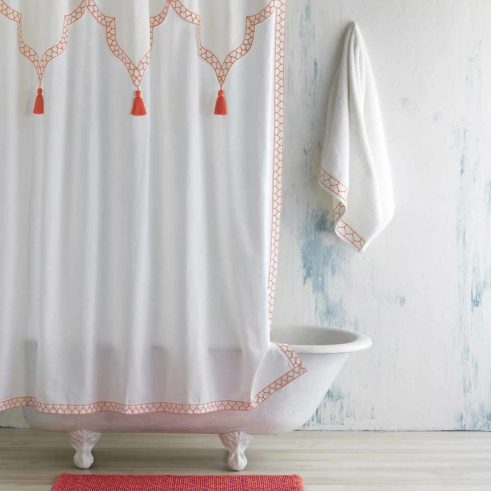 Orange accent shower curtain with orange rug