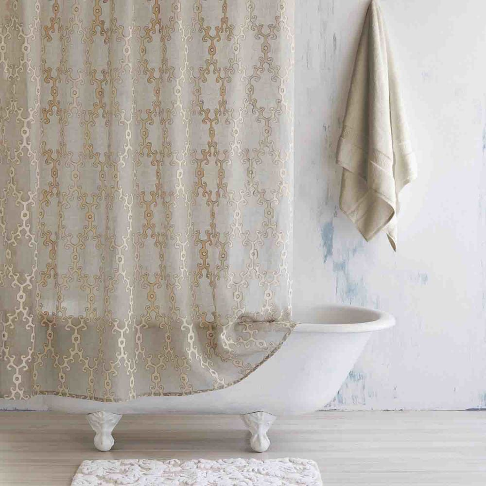 Beige pattern shower curtain and white rug