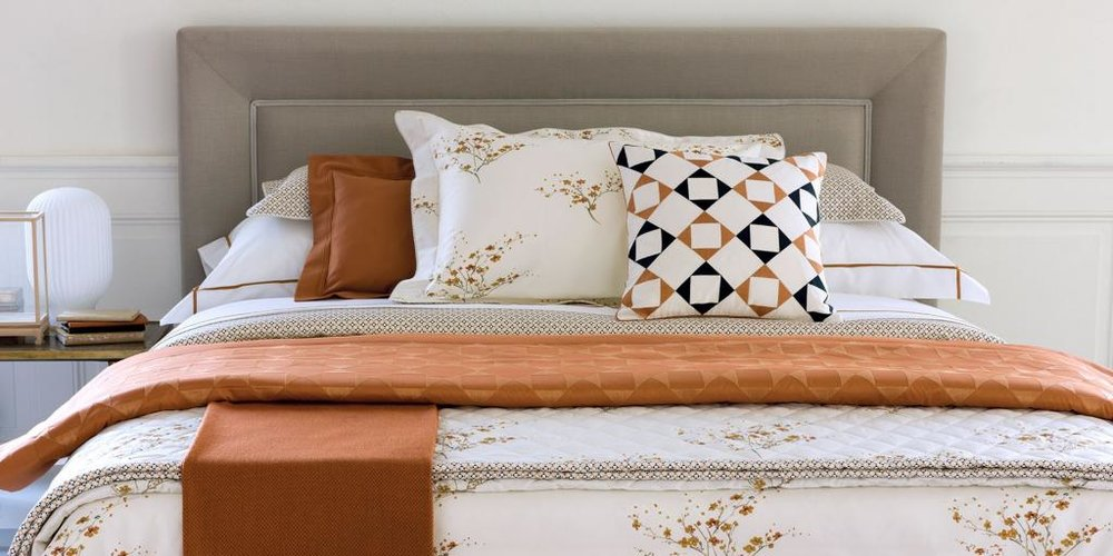Multiple warm colored pattern linens
