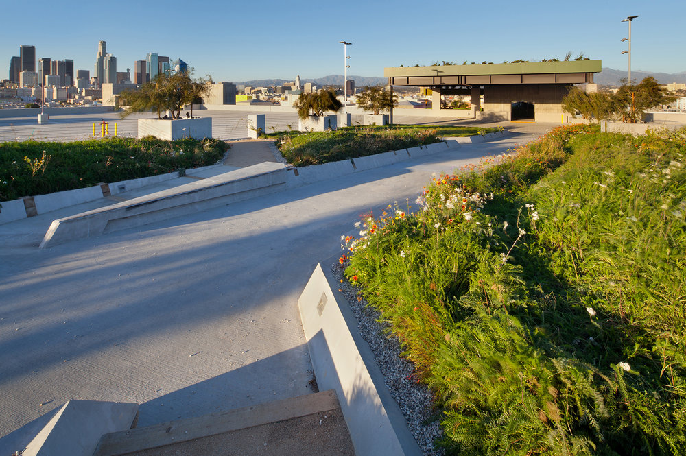 At ROW DTLA, a primary goal was to for the landscape to envelope the structures. A garden tops a parking structure within the urban context.