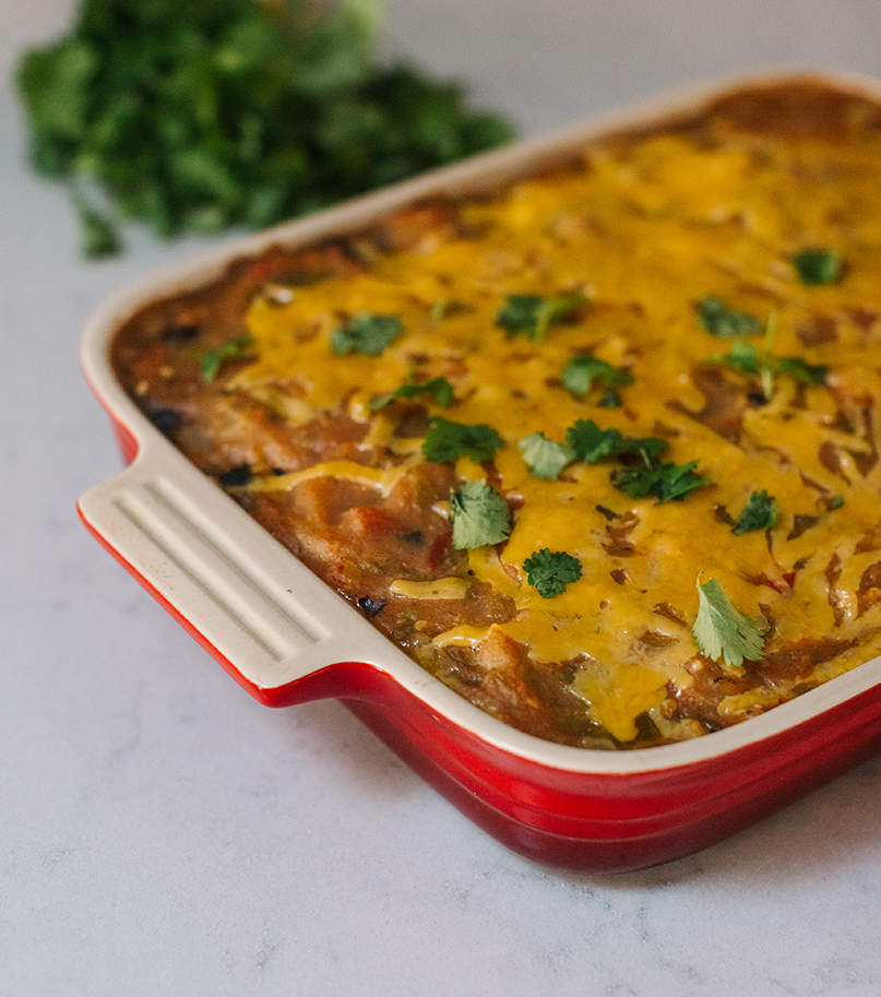 Easy Enchilada Casserole - This is great for nights when you have guests, as it can feed a crowd. It also makes a tasty vegetarian meal — just leave out the chicken.2 Tbs extra virgin olive oil1 yellow onion, chopped 4 garlic cloves, pressed or finely chopped2 tsp cuminMeat from half of a roast chicken (skin removed), shredded 1 15-oz can black beans, drained 1 10-oz bag frozen, cubed sweet potatoes or butternut squash (or 2 sweet potatoes, roasted, skinned, and roughly mashed) 2 4-oz cans mild diced green chiles (or diced fresh chiles from Okagawa Farms)½ cup cilantro, plus more for serving2 handfuls fresh spinach 2 16-oz jars Hatch Valley 505 Southwestern Mild Green Chile Sauce (or your favorite enchilada sauce) 8 corn tortillas, torn into pieces (try Sombrerito brand, made in Olathe and available at City Market)2 cups shredded cheddar or Monterey Jack cheese1 bunch of green onions, choppedSour cream or plain Greek yogurt1. In a saucepan, heat the olive oil over medium heat. Add the yellow onion to the pot and cook until softened. Add the garlic and cumin, stirring for 1 minute. Turn the heat to low and add the chicken, beans, sweet potatoes, green chiles, and cilantro. Stir to combine. Add the spinach, stirring constantly until it wilts. Turn off the heat, and stir in one jar of the sauce. 2. In a lasagna pan or slow cooker, pour enough sauce to coat the bottom. Add a layer of tortilla pieces, a thick layer of the chicken and bean filling, and top with a layer of cheese. Repeat the layers until the filling is gone. Top the casserole with the remaining sauce. (At this point the casserole can be stored in the refrigerator for up to three days or in the freezer for up to three months.)3. Bake at 350° until bubbly, about 30 minutes (1 hour 15 minutes from frozen). If you're slow cooking, cover and cook on low for 4-6 hours. 4. To serve, top with chopped green onion, cilantro, and sour cream or yogurt.