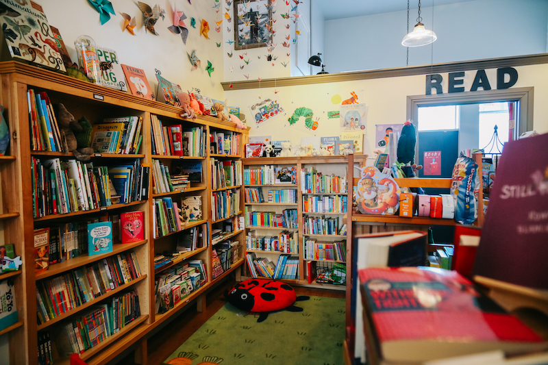 Out West Books   This cozy bookstore feels like a well-loved home. The children's corner is complete with a table, chairs, and a soft ladybug where kids can snuggle up with a book from the expertly curated selection. Children enjoy story time every Wednesday at 10:30am. 533 Main St. •   outwestbooks.co