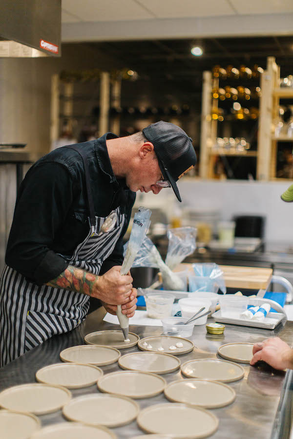 Chef Josh Neirnberg prepares a custom menu for a private event at Dinnerparty in downtown Grand Junction / Owner of Bin 707 Foodbar, Tacoparty, and Dinnerparty in Grand Junction / Visit Grand Junction board member