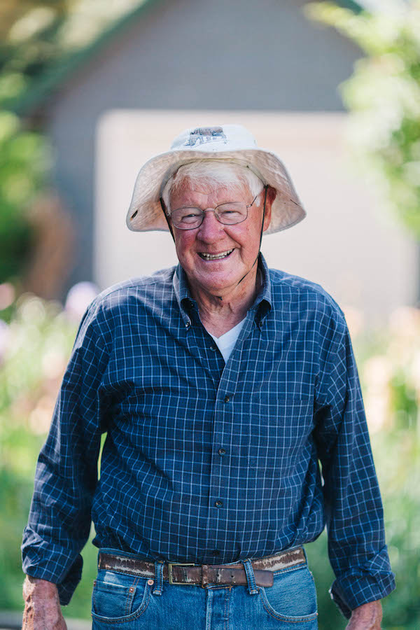 "Dr. Earl Young says, ""[Gardening] is certainly rejuvenating, and it gives me a good sense of accomplishing something. There's a lot of excitement raising a garden. It gives me life and hope when I get to see the plants start coming up.""   Photography by  Cat Mayer"