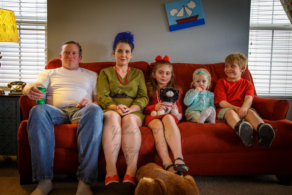 """The """"Simpson"""" Family, Notice the dog digging under the couch."""