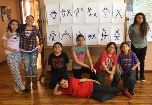 Cuts Wood Blackfeet Immersion School students showing winter count symbols.
