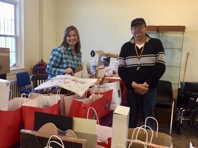 Sue Cox and David Dragonfly of Museum of the Plains Indian are ready to hand out art supplies.