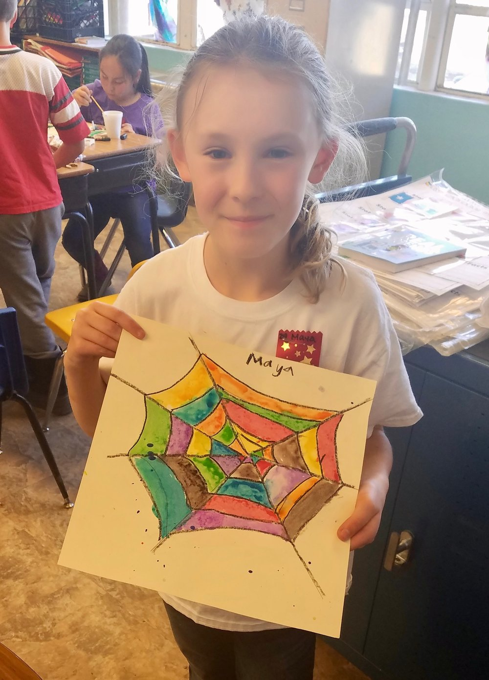 An East Glacier Park School student shows her art made with donated supplies.