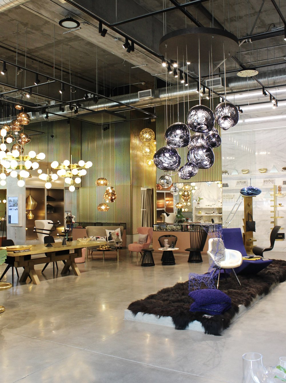 Up next,  Tom Dixon at The Shop . If you guys don't know about Tom Dixon, he's a British lighting and home decor designer. He creates the most stunning home furnishings and the aesthetic is right up my ally. I've taken countless pictures inside here because I'm always mesmerized by the decor.