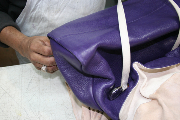 Call Meurice regarding leather bag restoration and stain removal.