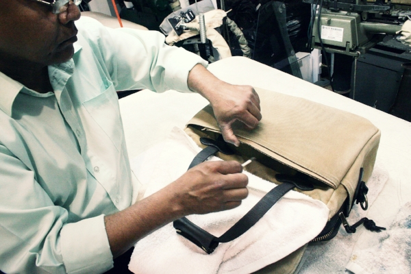 Our expert tech Hassan applies specially formulated dye to scratched leather.