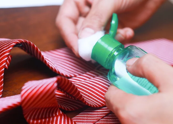 Rubbing alcohol can ruin your tie's finish. via WikiHow