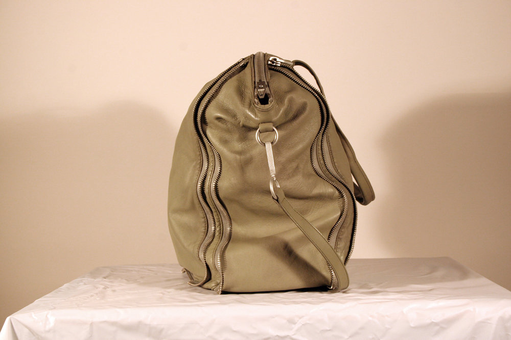 The bag is essentially brand new--the leather has been cleaned, repainted, and moisturized.