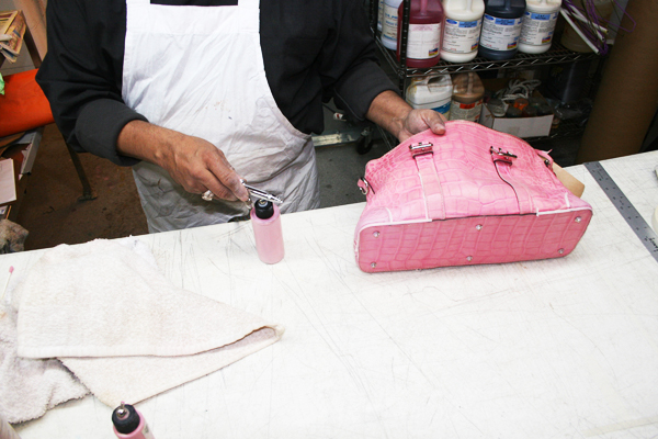 Our expert craftsman restoring a crocodile skin handbag using delicate color-matching techniques. Have a crocodile purse or handbag you need restored? Call us today at 212-475-2778