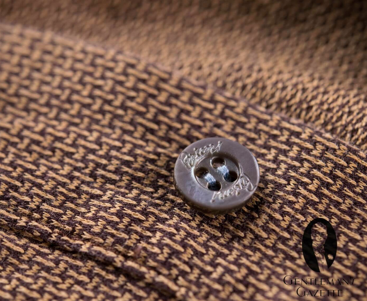 At Meurice, we often come across buttons that have to be physically removed before washing to prevent damage. They are sewn back on individually after pressing. GENTLEMAN'S GAZETTE / YOUTUBE