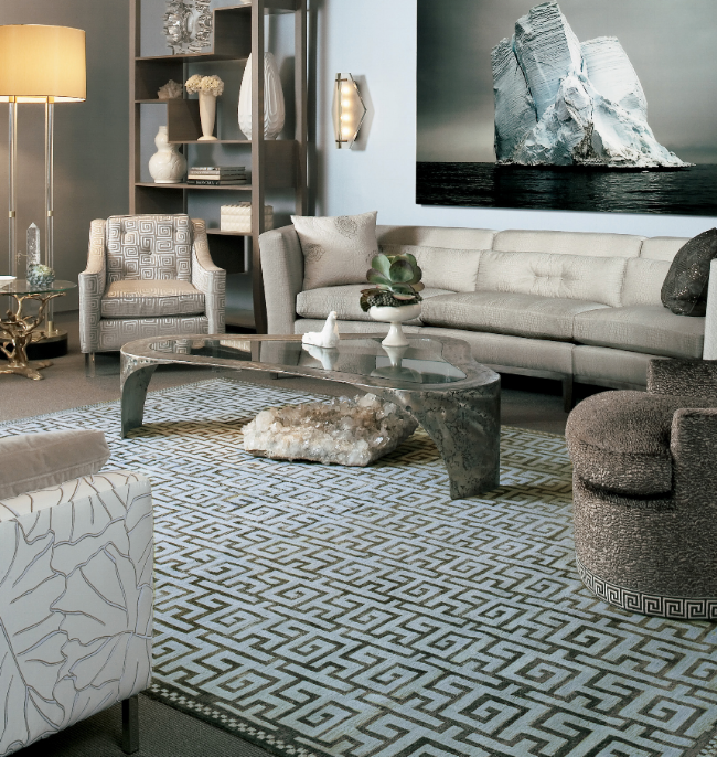 A typical Manhattan living room with a light blue and grey patterned area rug.