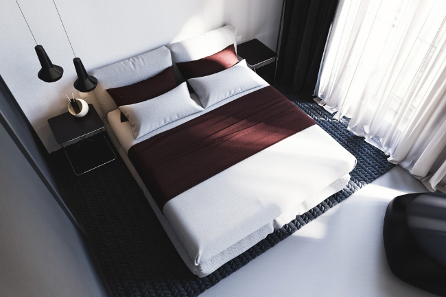 A freshly spread bed with hand-pressed sheets and linens.
