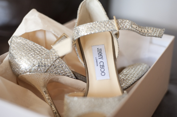 A pair of newly boxed Jimmy Choo, snakeskin heels.