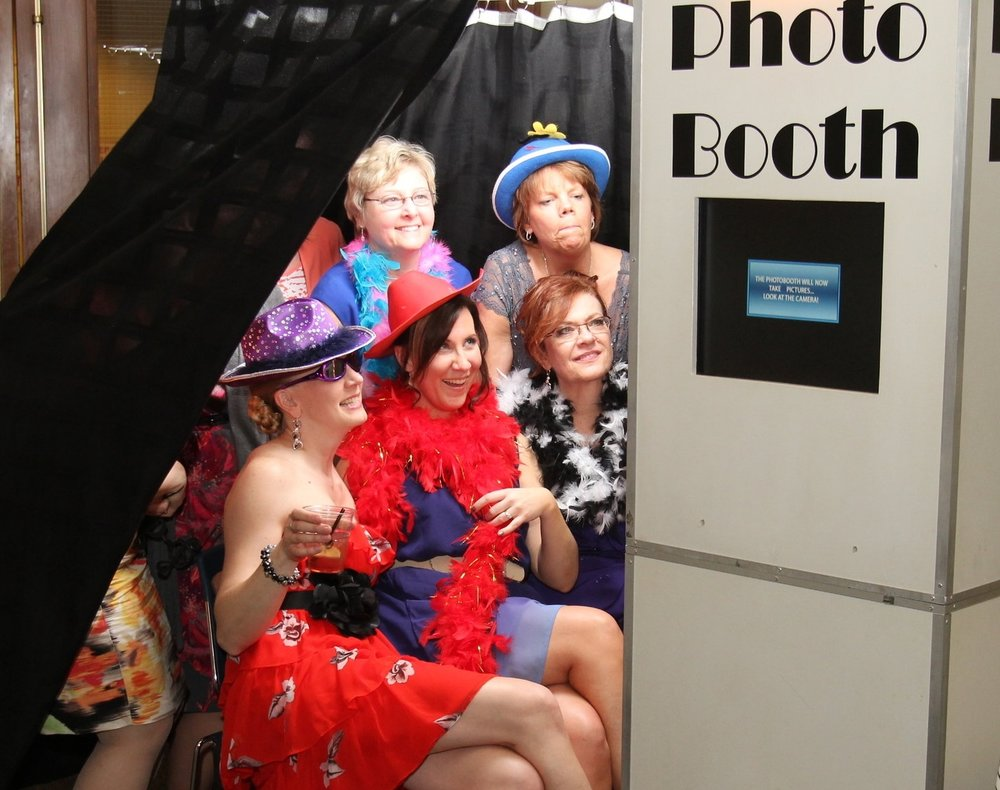 PhotoBooth - Six PhotoBooths to choose from! The Classic, Vintage, Modern, RingO, Mirror, or FotoPad. Your guests will have the most amazing time! Includes unlimited pictures, unlimited photostrips, props. scrapbook, digital copy of all pictures, and photobooth attendant. ($595 value)
