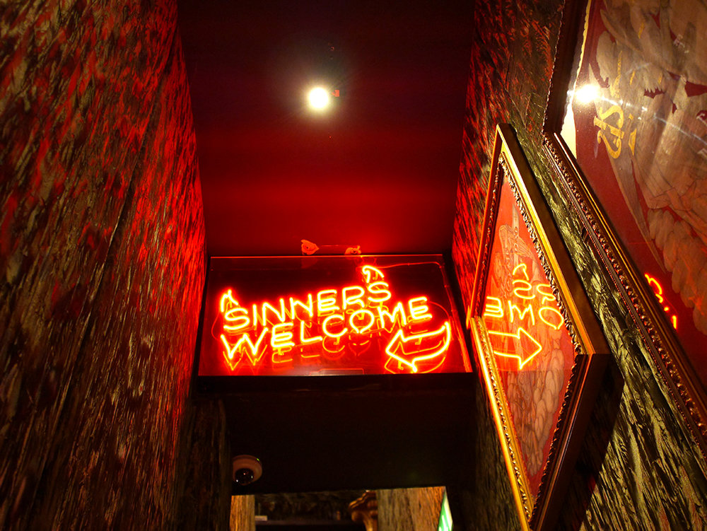 Sinners Welcome sign at The Spaniard