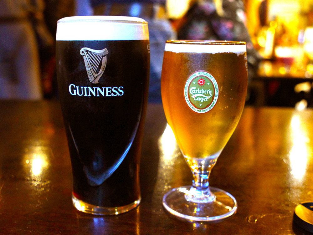 Pints of Guinness and Carlsberg at The Spaniard