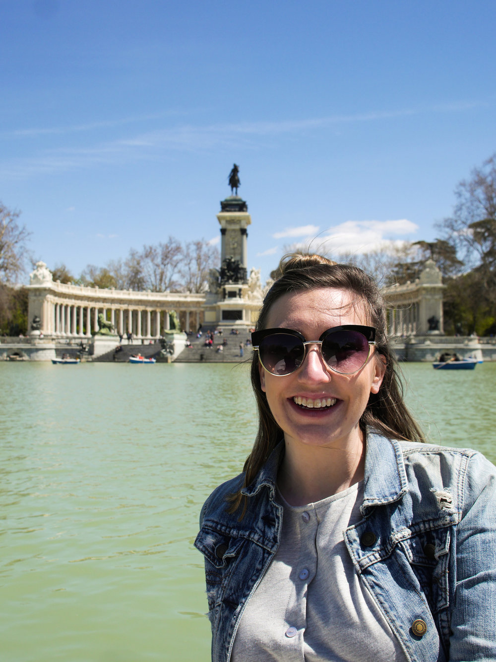 Candid Alexandra in front of the Monument to Alfonso XII in Madrid, Spain
