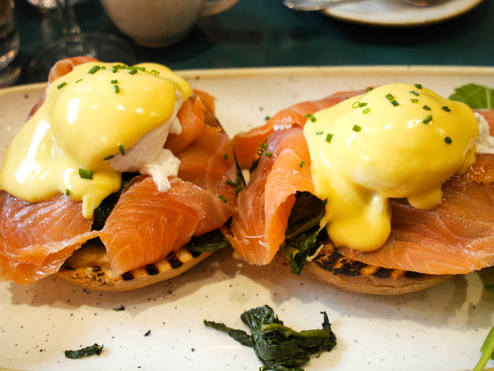 2 poached eggs on toasted bagel - Popeye w/ oak smoked organic salmon & spinach at San Lorenzo's in Dublin Ireland