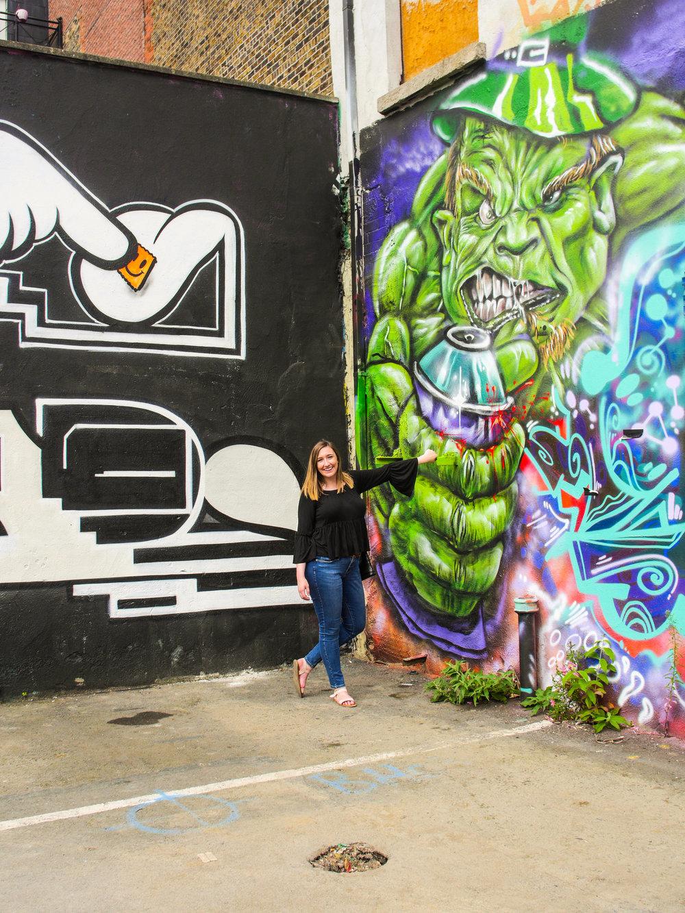 Candid Alexandra with street art at Tivoli Theatre in Dublin, Ireland