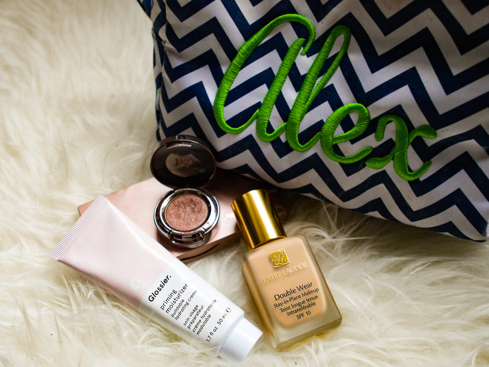 Makeup bag with Glossier, Urban Decay and Estee Lauder makeup