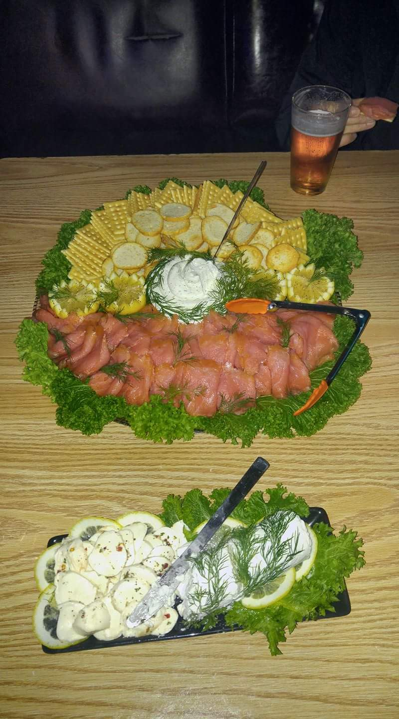 Salmon Platter $70 comes with cheese, crackers, lemon, and dill.