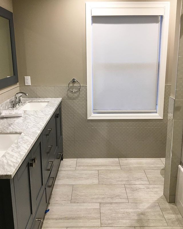 A clean, simple and cost effective bathroom for this client to enjoy for many years. 🚿 Our in-house designers are here to help you find the perfect tile to fit your taste & budget. | #bathroomdesign #designinspo #texture #interiordesign #ceramiccreations