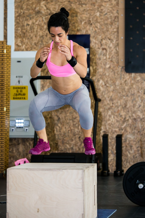 Female CrossFitter performing a boxjump