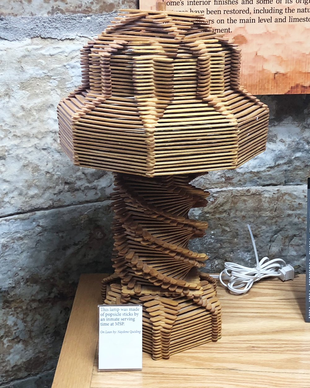 Lamp made from popsicle sticks by MSP inmate, displayed in museum